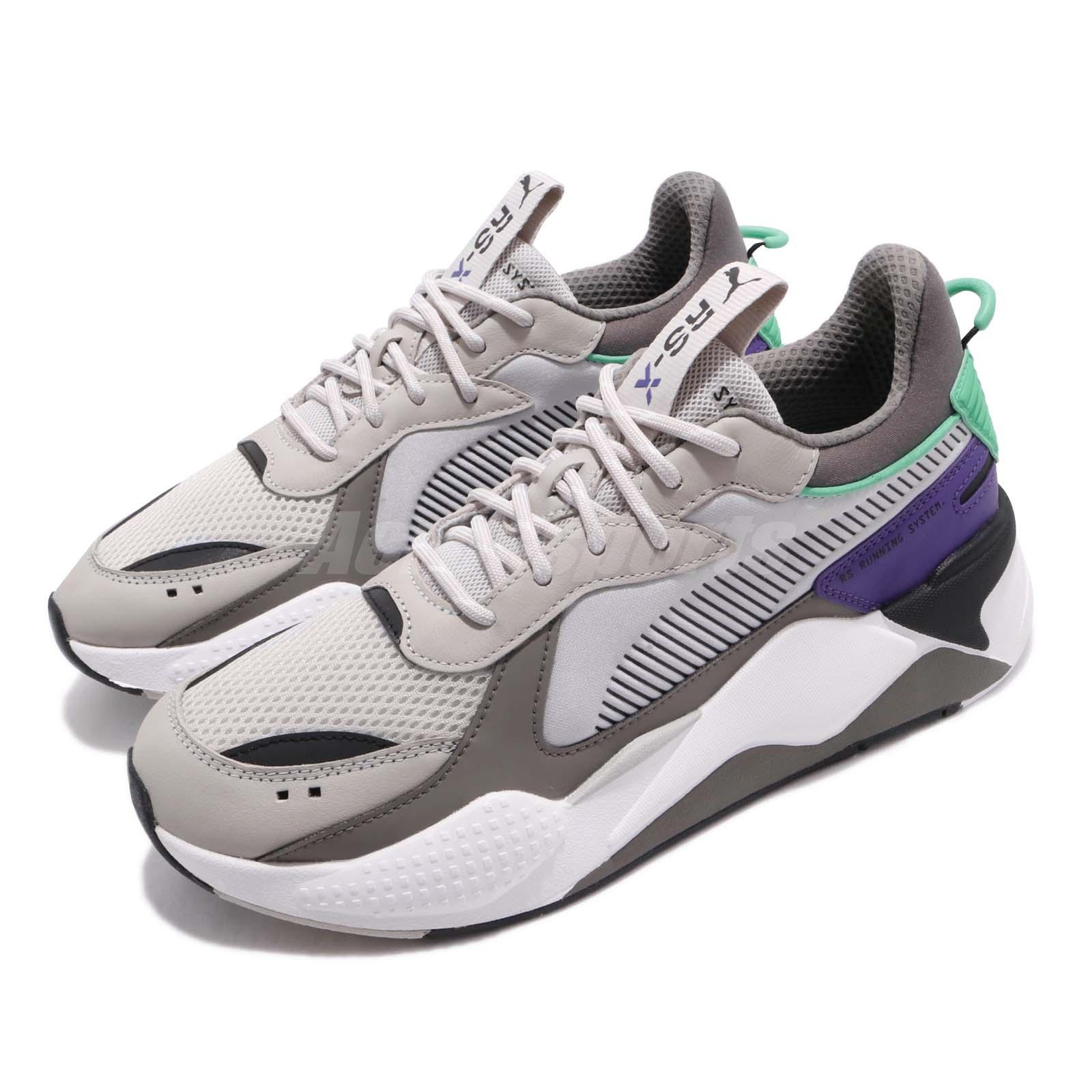grey and green puma shoes